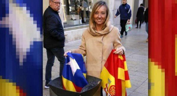 Marisa Xandri tirando la estelada a la basura