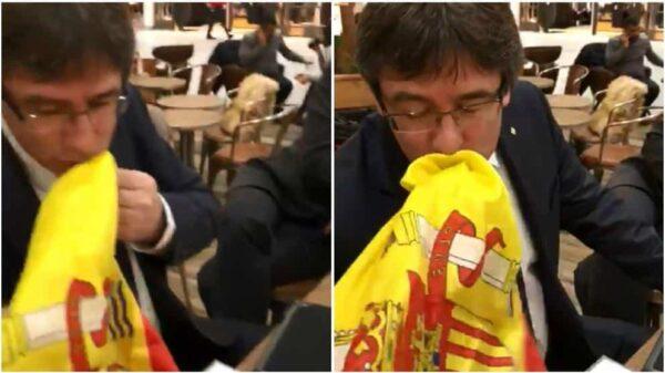 Puigdemont dio dos besos a la bandera de España ante el hombre que le increpaba