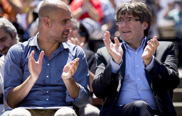 Pep Guardiola y Carles Puigdemont en un acto independnetista