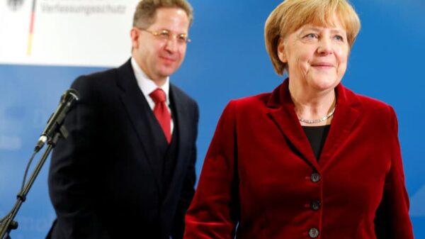 Hans-Georg Maasen y Angela Merkel