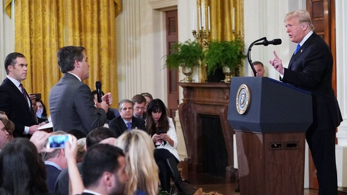 Donald Trump y el periodista Jim Acosta, de CNN