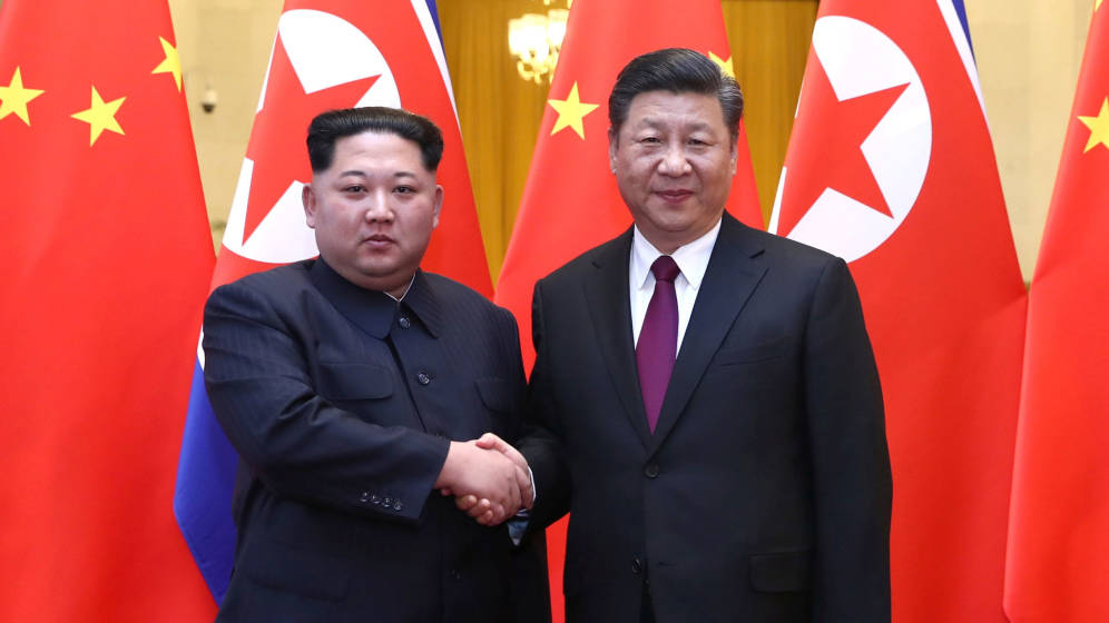 Kim Jong-un con el presidente chino, Xi Jinping