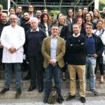 Los doctores Cebrian y Montesdeoca con Menick y asistentes a la conferencia